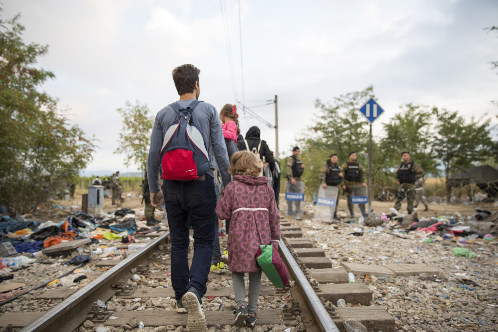 Refugees and migrants cross the border from Greece into Macedonia, near the village of Idomeni, Greece, 24 August 2015.